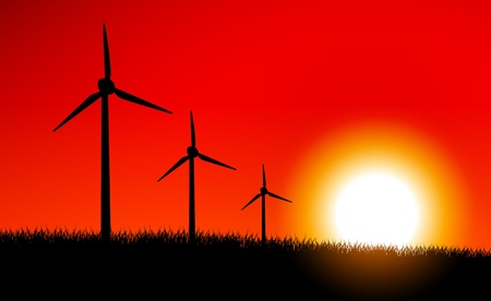 Sunset above field with windmills Vector