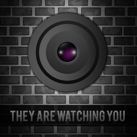 big eye: Webcam on gray bricks wall