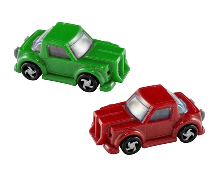Green and red toy cars isolated photo