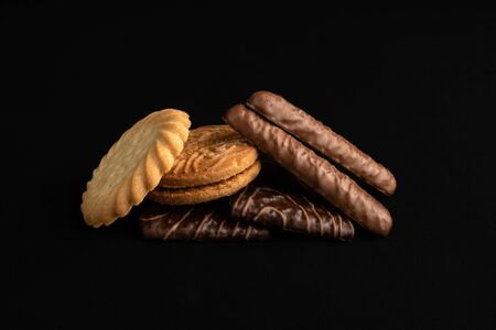 Selection of biscuits isolated on a black background