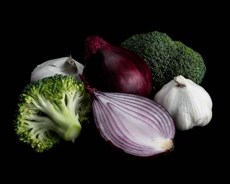 Fresh vegetables isolated on a black background