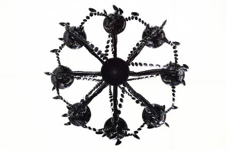 under black chandelier Stock Photo