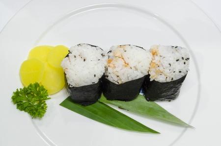 three nigiri sushi on dish