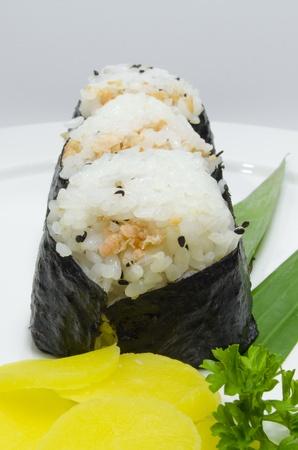 three nigiri sushi vertical