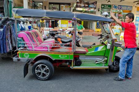tuk tuk car side view with driver in khaosan road