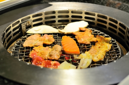 Roasting food on barbecue stove Stock Photo