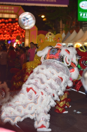 Chinese lion dance - chinese new year 2013 at yaowarat china town of thailand Stock Photo - 18018760
