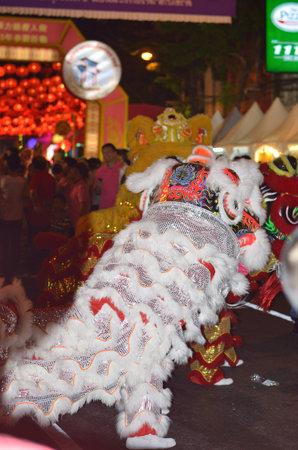 Chinese lion dance - chinese new year 2013 at yaowarat china town of thailand Stock Photo - 18018760