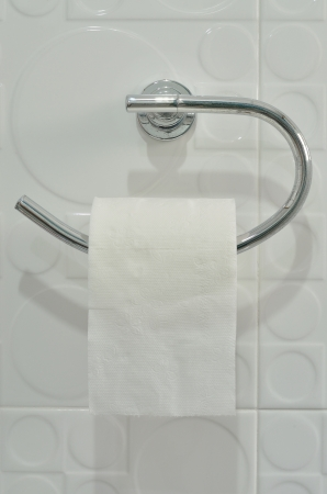 furl: bathroom tissue hang on the holder Stock Photo