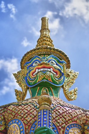peaceably: thai giant portrait at temple of the emerald buddha in bangkok thailand (wat phra kaew)