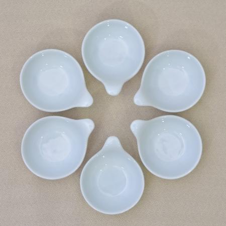 six empty mini white bowl sauce on the table linen