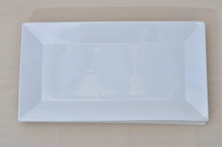 an empty rectangle white dish on a table linen Stock Photo