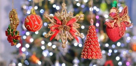 five red and gold christmas ornament hang on the bokeh  photo