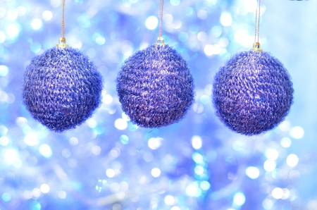 three blue pompom christmas decoration ball on bokeh  photo