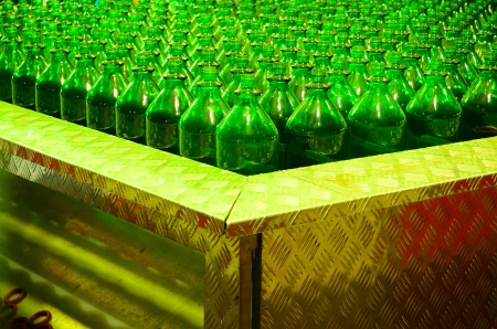 many green glass bottles for quoit game photo