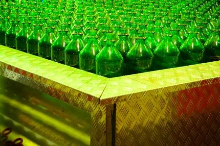 many green glass bottles for quoit game