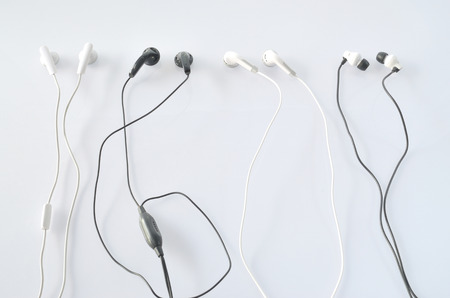 small talk and earphone on isolated background Stock Photo