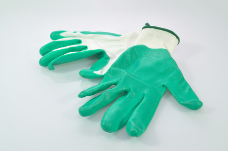 green and white rubber glove on white background