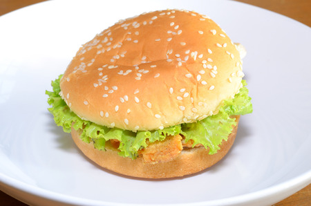 close up chicken burger on white dish Stock Photo