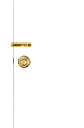 latch: golden knob and latch on white door