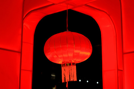 horizontal single red chinese lantern on black  background