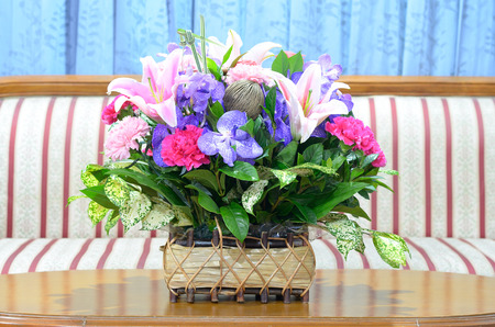 colorful flowers ina basket on the table Stock Photo