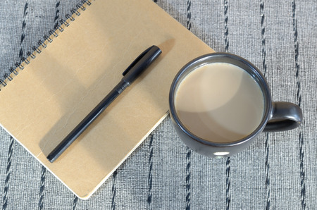 placemat: coffee cup with notebook and pen on placemat