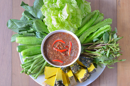 cow pea: shrimp paste chili sauce with vegetables on wood table