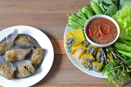 cow pea: shrimp paste chili sauce with vegetables and snakeskin gourami on wood table