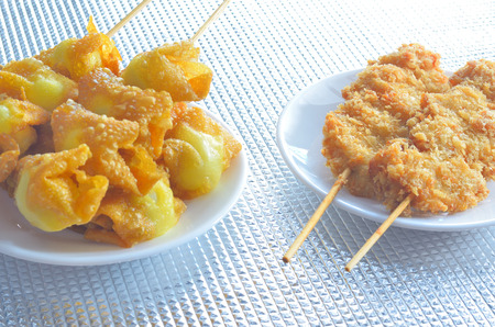 quail egg: fried quail egg wrapped in wanton sheet and fried chicken in brochette wooden stick