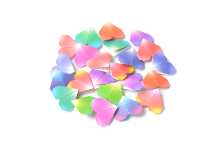 pile of paper: pile paper colors heart on white background