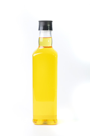 rice bran oil in a bottle on white background