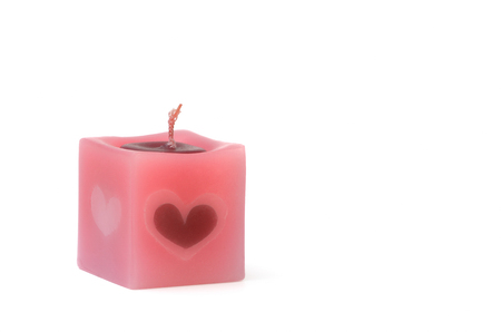 scented candle: square pink scented candle on white background Stock Photo