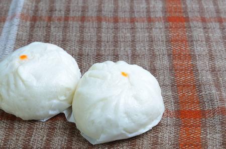 table linen: steamed stuff bun on table linen