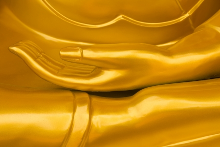 Closeup of a Buddha statue s open hand photo