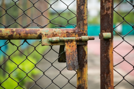 doors rusted iron fence on the tennis court photo