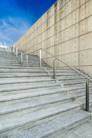stadium concrete stairs with blue sky and cloud photo