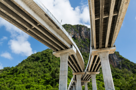 crossway: Under bridge expressway with blue sky and mountain