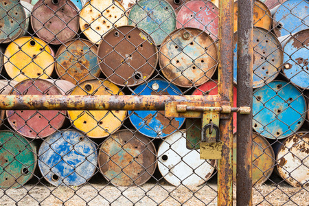 corrosion: doors rusted iron fence locked for old tanks containing hazardous chemicals