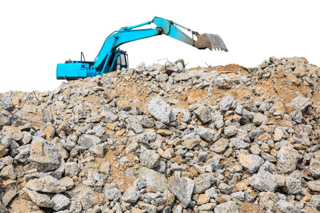 debris: pieces of concrete and brick rubble debris on construction site with loader on white background