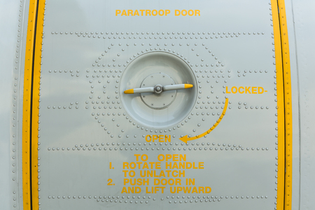 closeup paratroop door on military transport aircraft