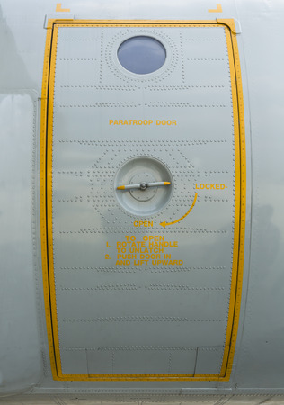 paratroop door on military transport aircraft