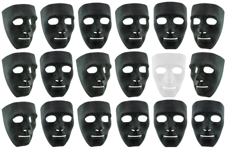 goodness: The white mask in surrounded by many black masks isolated on white, concept of goodness is in the midst of bad