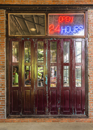 Open 24 hours sign on the old crimson door with brick wall and cement floor in & Open 24 Hours Sign On The Old Crimson Door With Brick Wall And ... Pezcame.Com