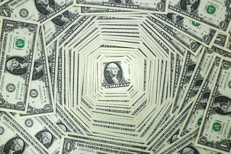 large group of business people: A pile of one dollar bill hangs over each other as background