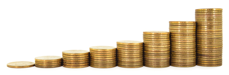 Stack of one dollar coins arranged as a graph isolated on white background, concept of economic and business growth
