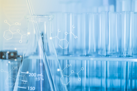 erlenmeyer: Laboratory glass Erlenmeyer flask and glass rod with test tubes in test tubes rack and chemical formula, science background Stock Photo