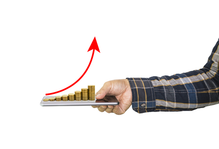A male hand holding mobile phone and money coin stack arranged as a graph on top with red arrow indicates money growth upturn isolated on white background, concept of money growth