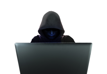 Computer hacker in black mask and hood isolated on white background