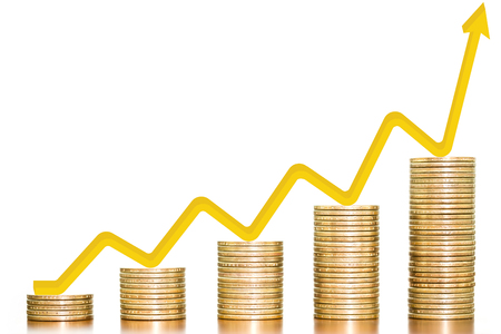 Stack of money coins arranged as a graph on wooden table with gold arrow indicates economic upturn on white background, concept of business growth and finance